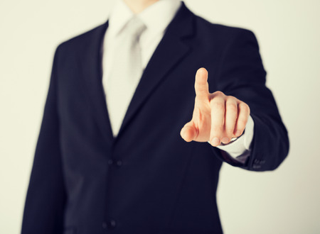 picture of man hand pointing at something Stock Photo