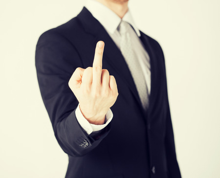 insulting: close up of man showing middle finger Stock Photo