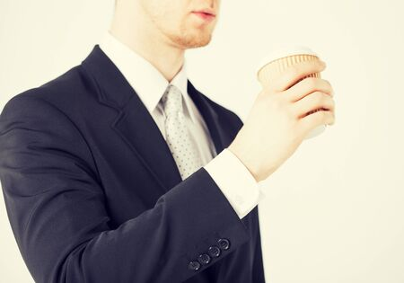 take away: man hand holding take away coffee cup
