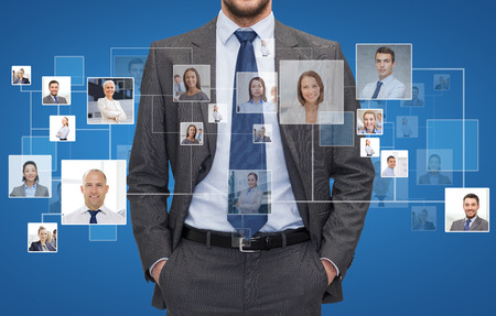 close up of businessman over blue background with icons of contacts Stock Photo