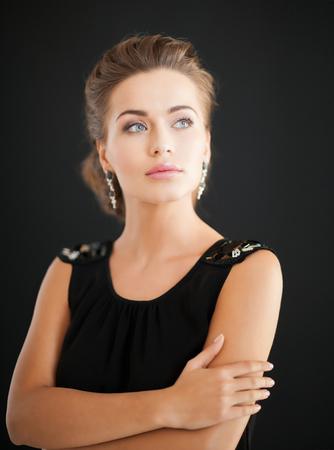 diamond earrings: beautiful woman in evening dress wearing diamond earrings