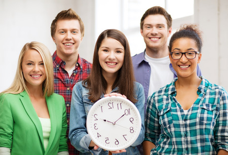 late teens: group of students at school with clock