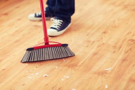 brooming: close up of male brooming wooden floor