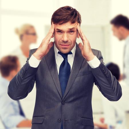 tired person: stressed businessman or teacher having headache