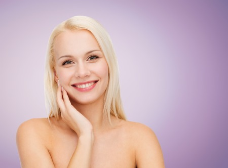 bare shoulders: beautiful young woman with bare shoulders over violet background