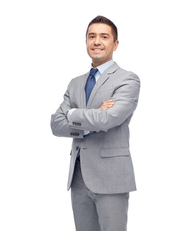 cheerful businessman: business, people and office concept - happy smiling businessman in suit