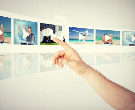 digi: technology, internet, tv and virtual screens concept - man pressing button on virtual screen with videos