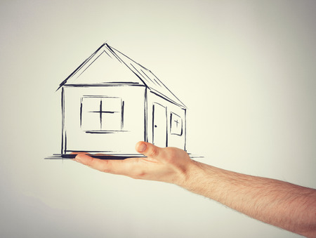 accomodation: real estate, technology and accomodation concept - picture of house on virtual screen in man hand Stock Photo