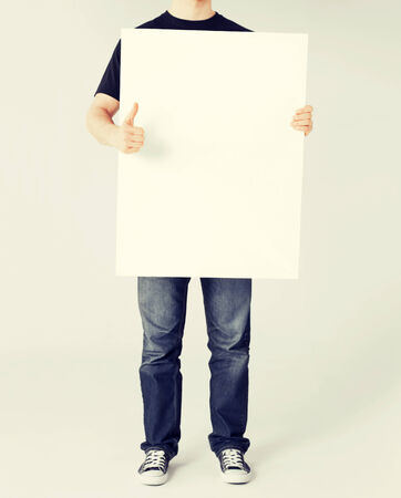 business and advertisement concept - man showing white blank board and thumbs up photo