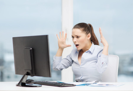 business, office, school, problem, crisis, stress and education concept - stressed businesswoman with computer and documents at work