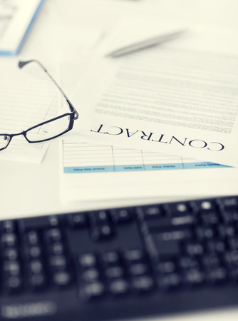 signed: picture of signed contract paper with glasses Stock Photo