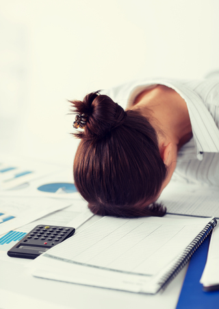 overworking: picture of woman sleeping at work in funny pose