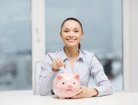 finance girl: banking and finances concept - lovely woman with piggy bank and cash money