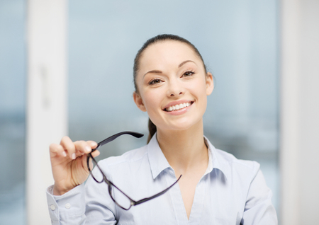 eyeglasses: business and education concept - laughing businesswoman with eyeglasses