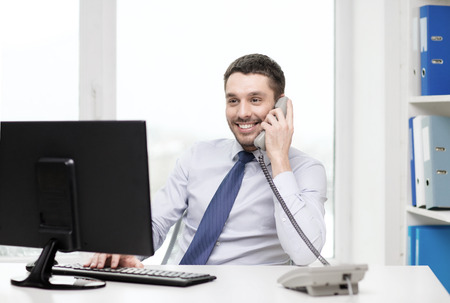 office, business, education, technology and internet concept - smiling businessman or student with computer and phone