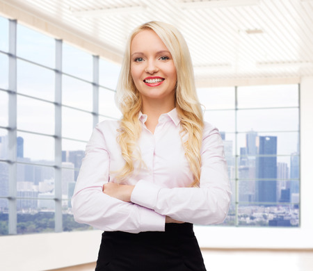 view of an elegant office: business, style and people concept - smiling businesswoman, student or secretary over office window with city view background
