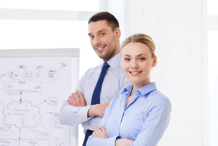 entrepreneurs: business, teamwork and people concept - smiling businessman and businesswoman in office Stock Photo