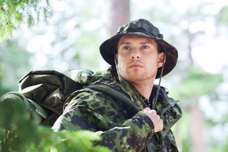 infantryman: war, hiking, army and people concept - young soldier or ranger with backpack in forest Stock Photo