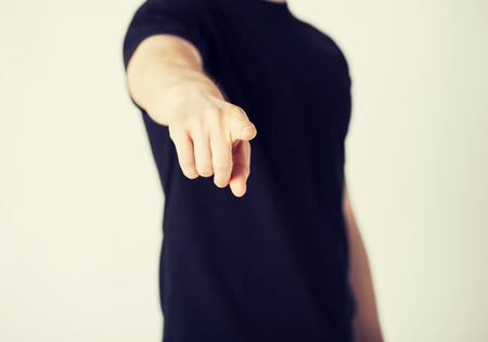 accusing: close up of man pointing his finger at you
