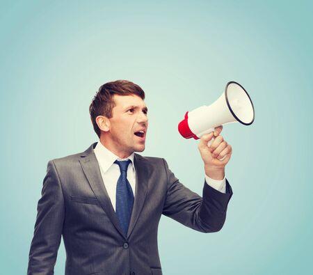 loudhailer:  buisnessman with bullhorn or megaphone Stock Photo