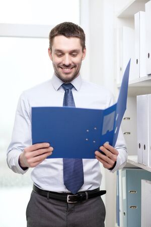 smiling businessman with folder office photo