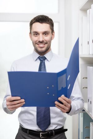 business, office and archive concept - smiling businessman with folder office photo