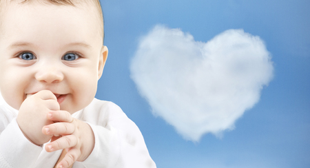 child, happiness and people concept - adorable baby Stock Photo
