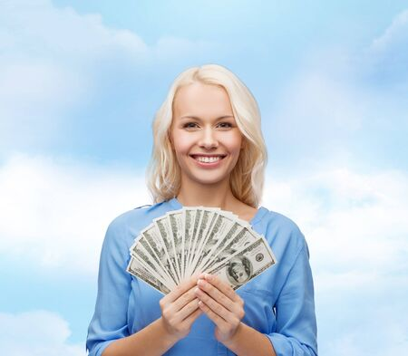 holiday profits: finances and people concept - smiling woman in red dress with us dollar money