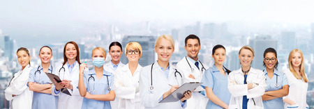 doctor clipboard: smiling female doctors and nurses with stethoscope Stock Photo