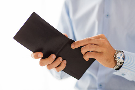 money wallet: people, business, finances and money concept - close up of businessman hands holding open wallet