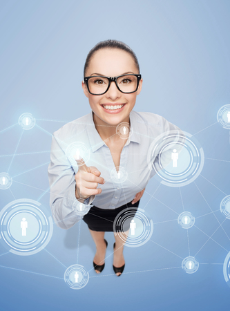 link up: business and emotion concept - smiling businesswoman with finger up