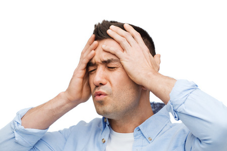 male headache: stress, headache, health care and people concept - unhappy man with closed eyes touching his forehead