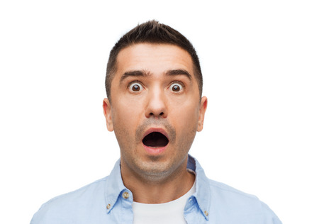 facial expression: fear, emotions, horror and people concept - scared man shouting