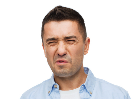 stinky: emotions, facial expression and people concept - man wrying of unpleasant smell Stock Photo