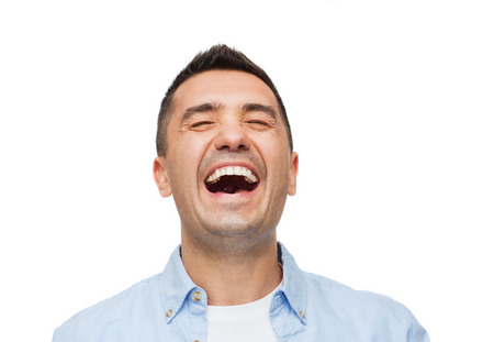 hilarious: happiness, emotions and people concept - laughing man