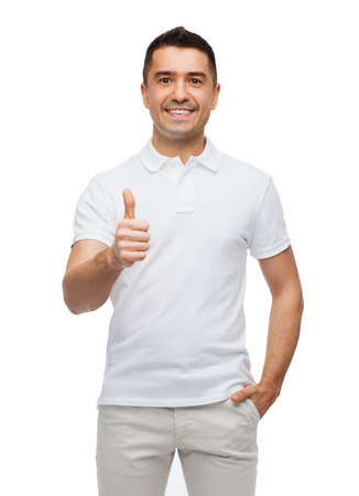mid adult male: happiness, gesture and people concept - smiling man showing thumbs up