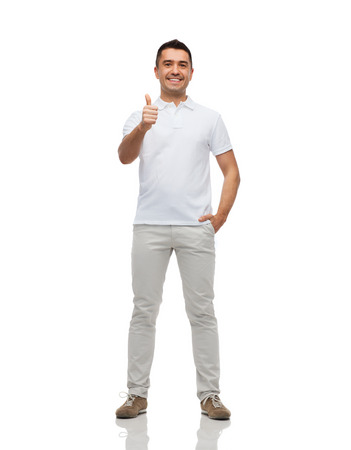 happiness, gesture and people concept - smiling man showing thumbs up