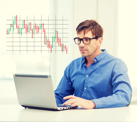 stock prices: technology, business and lifestyle concept - man in eyeglasses working with laptop at home