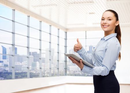 manager office: education, business and technology concept - smiling businesswoman or student with tablet pc computer over office room or new apartment background