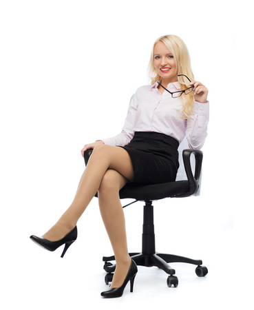 smiling businesswoman, student or secretary over white background photo