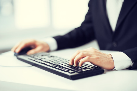 send email: picture of man hands typing on keyboard Stock Photo