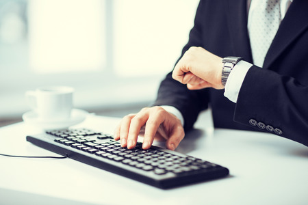 hand keyboard: picture of man hands typing on keyboard Stock Photo