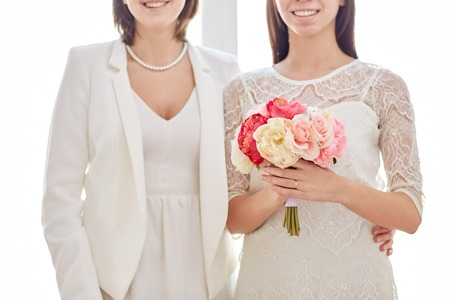 homosexual partners:  close up of happy married couple with flower bunch Stock Photo