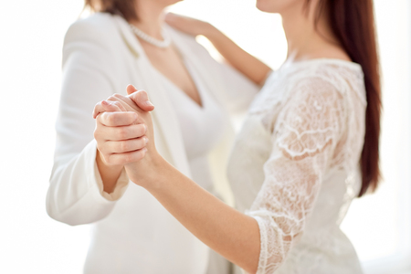beautiful couple: close up of happy married lesbian couple dancing