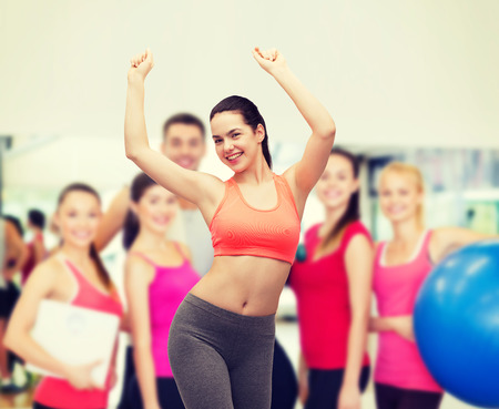 latin dancing: fitness and diet concept - smiling teenage girl in sportswear dancing