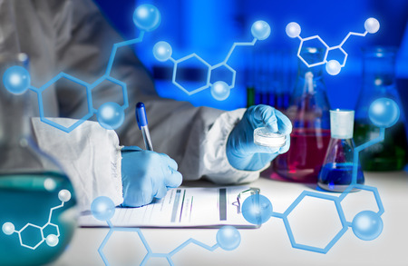 close up of young scientist with chemical sample taking notes on clipboard and making test or research in laboratory over molecular structure