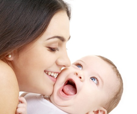 holding mother's hand: family and happy people concept - mother kissing her baby Stock Photo