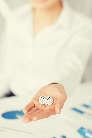 bisiness: business, office, winning, gambling concept - woman hands with gambling dices showing double six