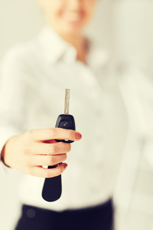 bisiness: business, banking, vehicle, rental, automotive concept - woman hand holding car key