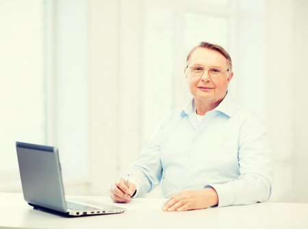 school form: business, tax, office, school and education concept - old man in eyeglasses filling a form at home Stock Photo